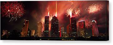 Fireworks Over Buildings In A City Canvas Print by Panoramic Images
