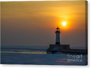 First Sunrise Canvas Print by Ronny Purba
