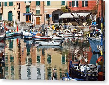Canvas Print featuring the photograph fishing boats in Camogli  by Antonio Scarpi