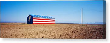 Flag Barn Along Highway 41, Fresno Canvas Print by Panoramic Images