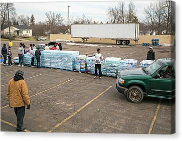 Pallet Canvas Print - Flint Bottled Drinking Water Distribution by Jim West