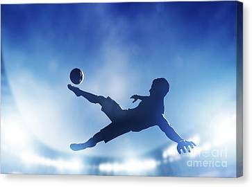 Football Soccer Match A Player Shooting On Goal Canvas Print by Michal Bednarek