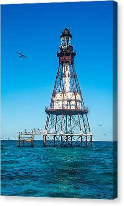 Fowey Rocks Lighthouse Canvas Print by Manuel Lopez