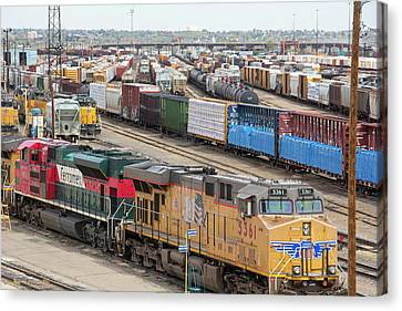 Freight Trains At A Rail Yard Canvas Print by Jim West