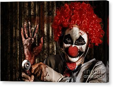 Frightening Clown Doctor Holding Amputated Hand  Canvas Print by Jorgo Photography - Wall Art Gallery