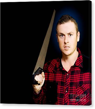 Frustrated Angry Man Brandishing A Saw Canvas Print by Jorgo Photography - Wall Art Gallery