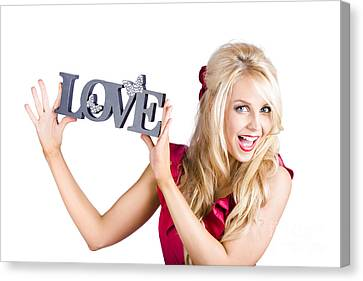 Fun Blonde Woman With Love Word Sign Canvas Print by Jorgo Photography - Wall Art Gallery
