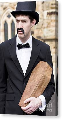 Youthful Canvas Print - Funeral Director With Coffin by Jorgo Photography - Wall Art Gallery