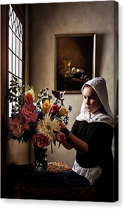 Canvas Print featuring the photograph Girl Arranging A Flower Bouquet In A Glass Vase by Levin Rodriguez