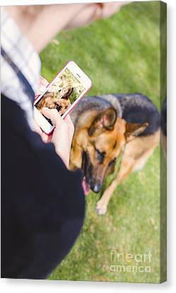 Girl Taking Photo Of Dog With Smart Mobile Phone Canvas Print
