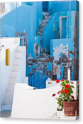 Glimpse Of Typical White Houses In Oia Santorini Greece Canvas Print by Matteo Colombo