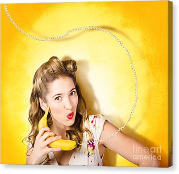 Gossiping Retro Pin Up Girl On Fruit Phone Canvas Print by Jorgo Photography - Wall Art Gallery