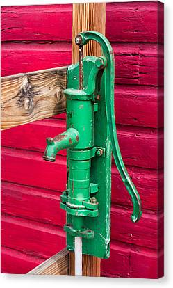 Green Manual Pump From Well Canvas Print by Gunter Nezhoda