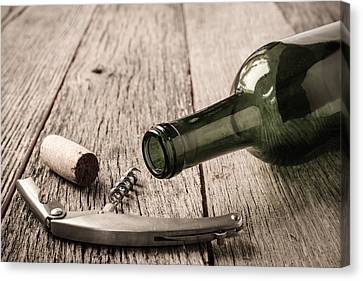 Green Wine Bottle And Cork With Red Wine And Corkscrew Canvas Print by Brandon Bourdages