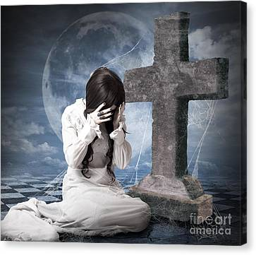 Grieving Gothic Girl Crying Next To Gravestone Canvas Print by Jorgo Photography - Wall Art Gallery