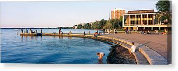 Group Of People At A Waterfront, Lake Canvas Print by Panoramic Images