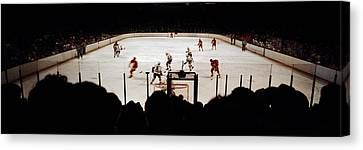 Group Of People Playing Ice Hockey Canvas Print by Panoramic Images