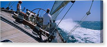 Group Of People Racing In A Sailboat Canvas Print