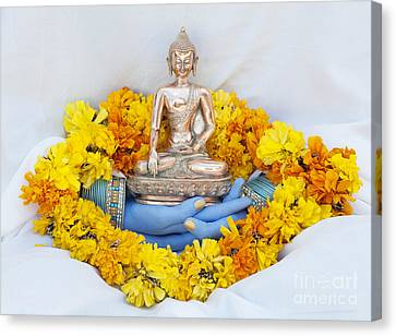 Hands Holding Buddha Canvas Print