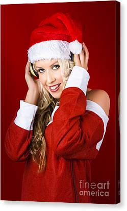 Happy Dj Christmas Girl Listening To Xmas Music Canvas Print by Jorgo Photography - Wall Art Gallery