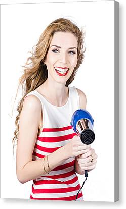 Happy Female Hairdresser Holding Hairdryer Canvas Print