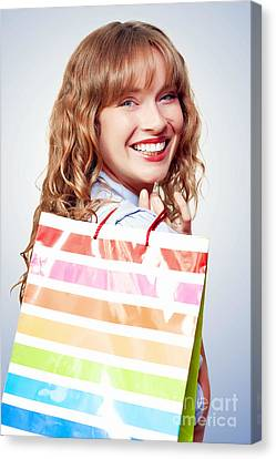 Happy Female Retail Shopper With Bag And Smile Canvas Print by Jorgo Photography - Wall Art Gallery