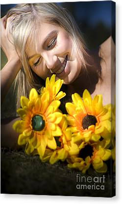 Happy Woman With Sunflowers Canvas Print