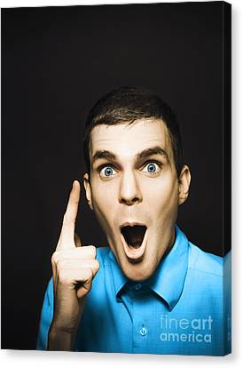 Happy Young Man Pointing At Blank Copyspace Canvas Print by Jorgo Photography - Wall Art Gallery