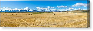Hay Bales In A Field With Canadian Canvas Print by Panoramic Images