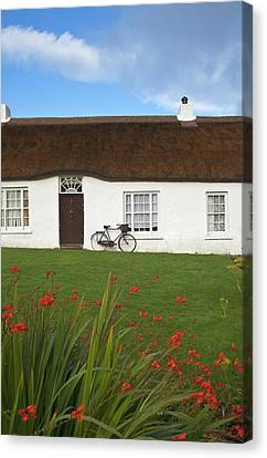 Hezletts Picturesque Thatched Cottage Canvas Print by Panoramic Images
