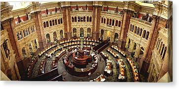 High Angle View Of A Library Reading Canvas Print by Panoramic Images