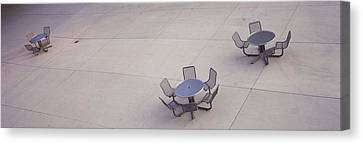 High Angle View Of Tables And Chairs Canvas Print by Panoramic Images