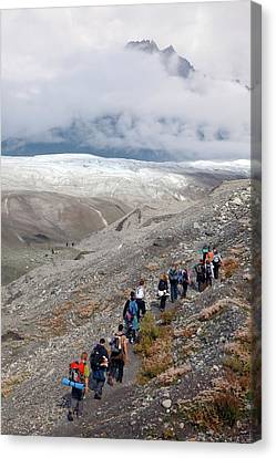 Hiking Trip To A Glacier Canvas Print by Jim West