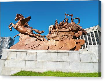 Horse Statue Before The Children's Canvas Print by Michael Runkel