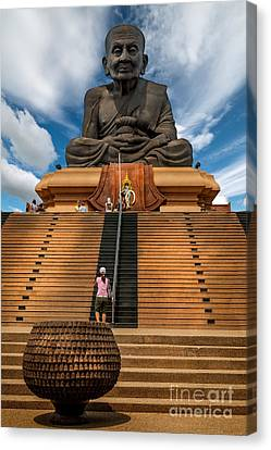 Huay Mongkol Temple Canvas Print by Adrian Evans