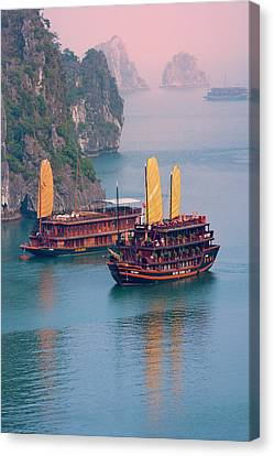 Junk Boat And Karst Islands In Halong Canvas Print by Keren Su