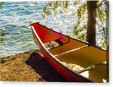 Kayak By The Water Canvas Print by Alex Grichenko