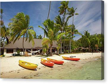 Kayak On The Beach, And Waterfront Canvas Print by David Wall