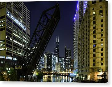 Kinzie Street Railroad Bridge At Night Canvas Print by Sebastian Musial