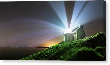 Lighthouse Beams At Night Canvas Print by Laurent Laveder