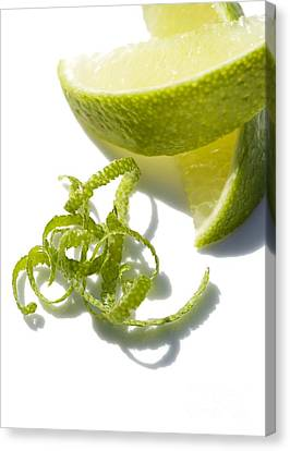 Lime Slices And Peel Canvas Print by Jon Stokes