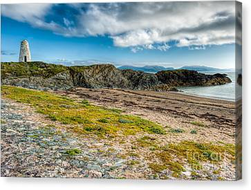 Llanddwyn Beacon Canvas Print by Adrian Evans