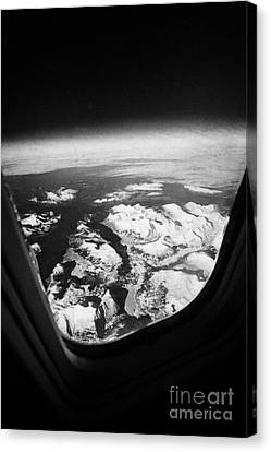 Looking Out Of Aircraft Window Over Snow Covered Fjords And Coastline Of Norway Europe Canvas Print by Joe Fox