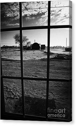 looking out through door window to snow covered scene in small rural village of Forget Saskatchewan  Canvas Print