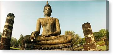 Low Angle View Of A Statue Of Buddha Canvas Print by Panoramic Images