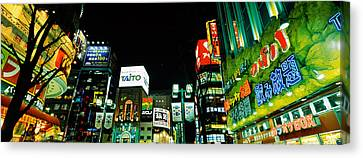 Low Angle View Of Buildings Lit Canvas Print by Panoramic Images