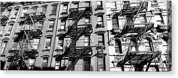 Low Angle View Of Fire Escapes Canvas Print by Panoramic Images