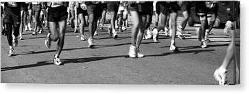 Low Section View Of People Running Canvas Print by Panoramic Images