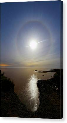 Lunar Halo Over Water Canvas Print by Luis Argerich