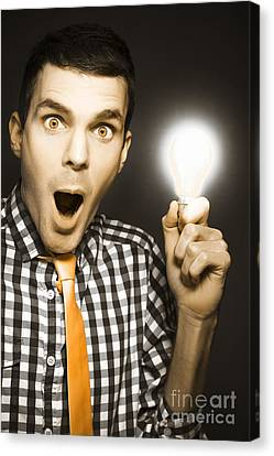 Male Business Person With Light Bulb In Hand Canvas Print by Jorgo Photography - Wall Art Gallery